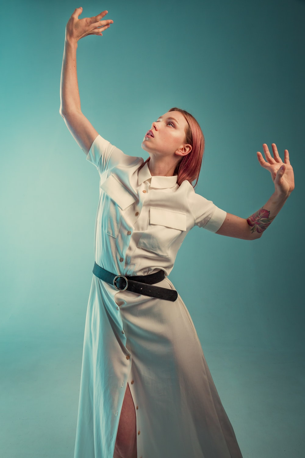 woman in white dress shirt with black leather belt