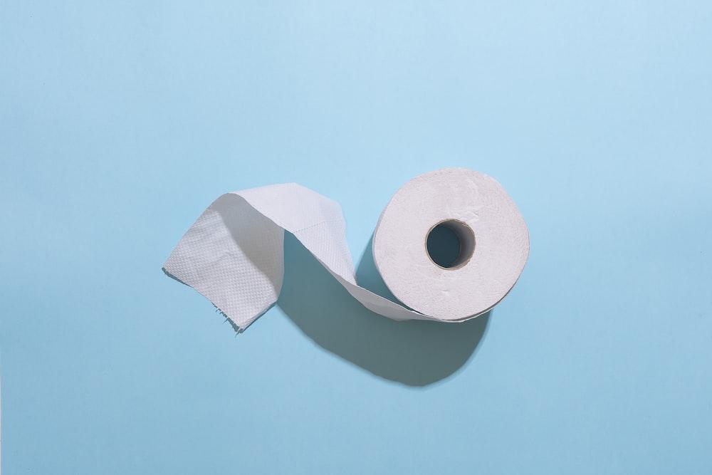 white toilet paper roll on white table