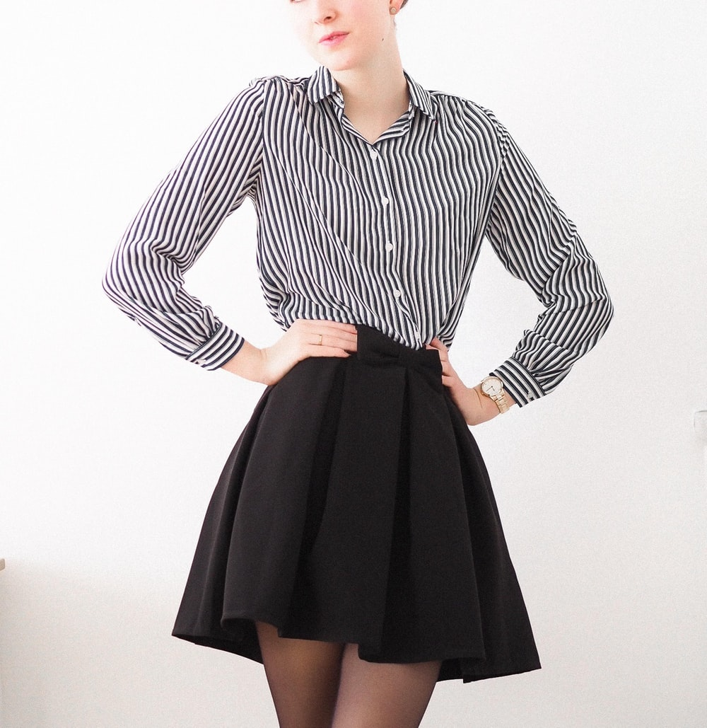 woman in black and white striped long sleeve dress