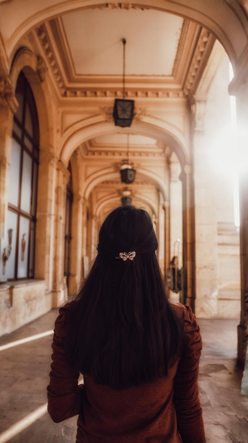 woman in black hijab standing on hallway