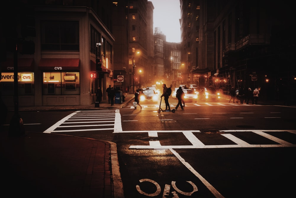 people walking on pedestrian lane during night time