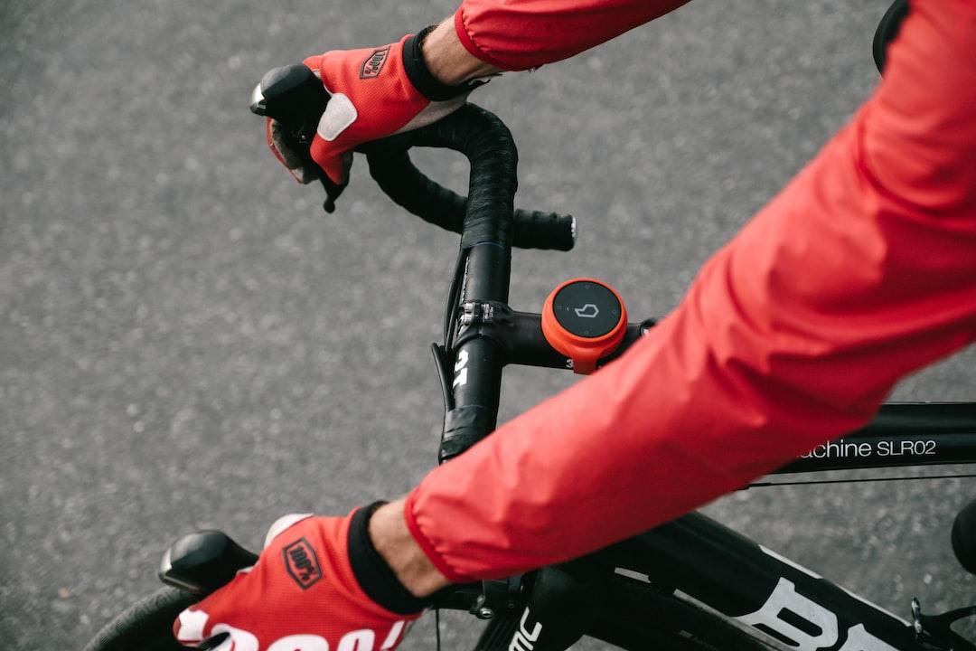 Cyclist taking a corner on carbon fibre road bike