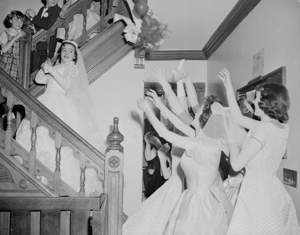 grayscale photo of bride and groom dancing