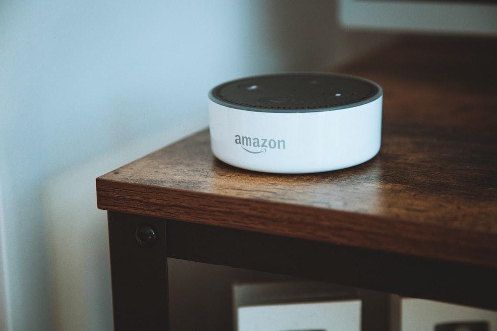 white and black round portable speaker