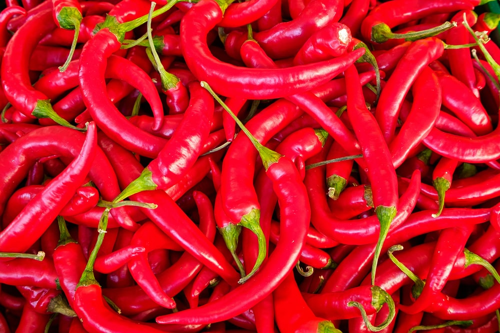 red chili peppers in close up photography