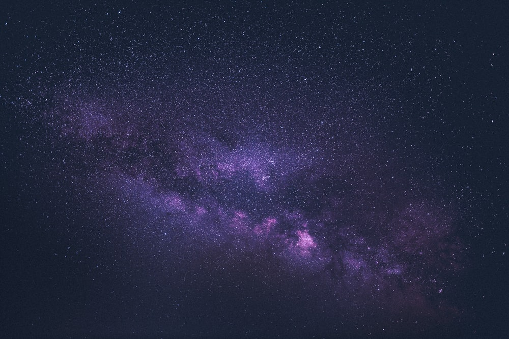 purple and black sky with stars