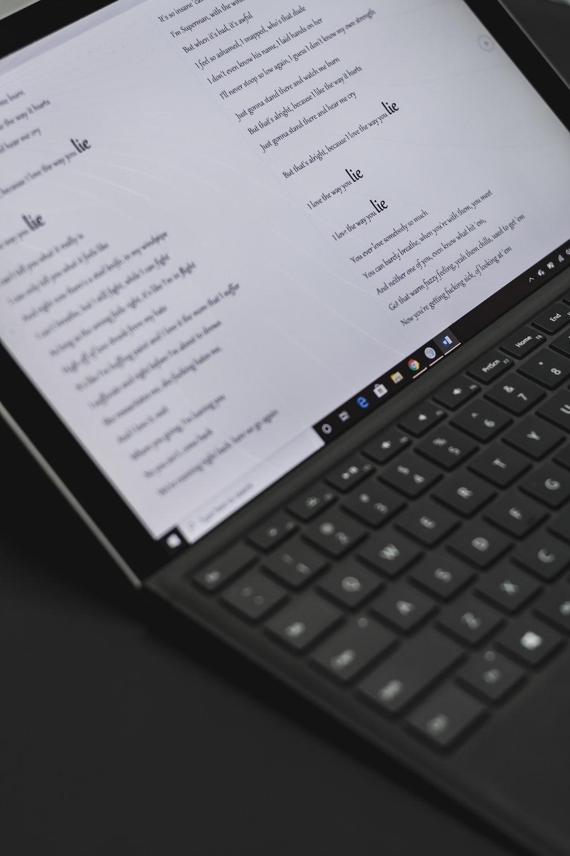 black laptop computer turned on displaying white screen