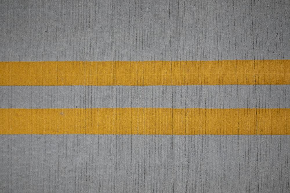 gray orange and yellow textile