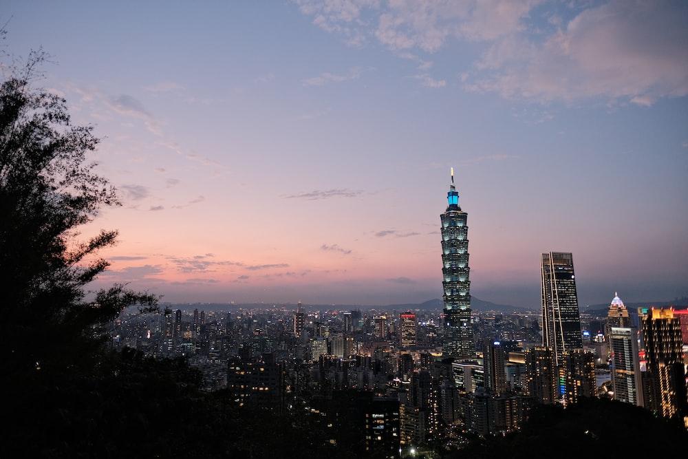city skyline under blue sky during sunset