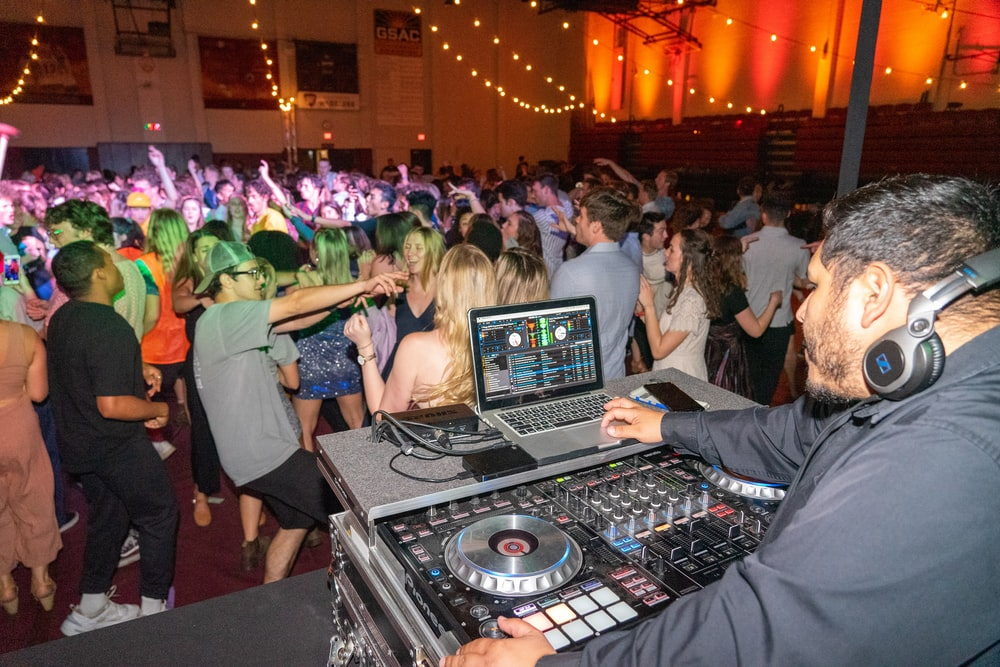 people sitting on chair in front of dj controller