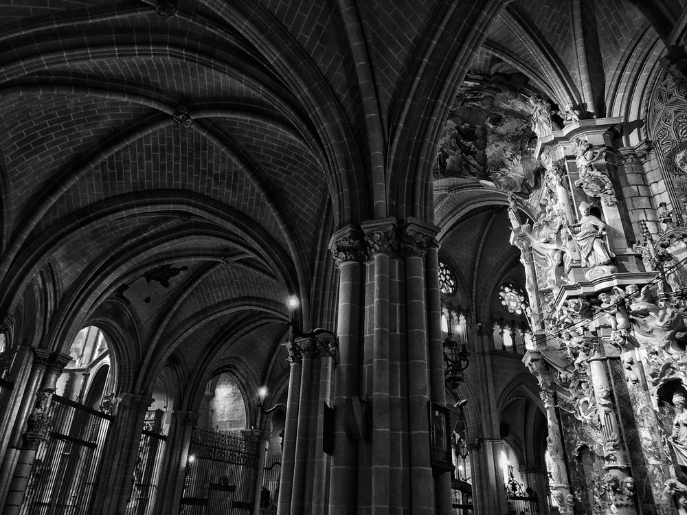 gray scale photo of cathedral interior