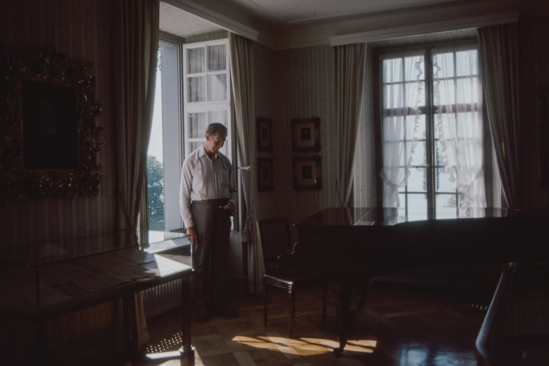 1970s 35mm film slide photo of a man standing in his living room