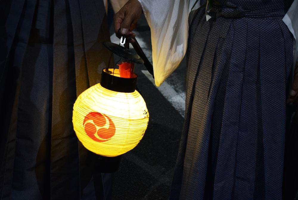 yellow and black round pendant lamp