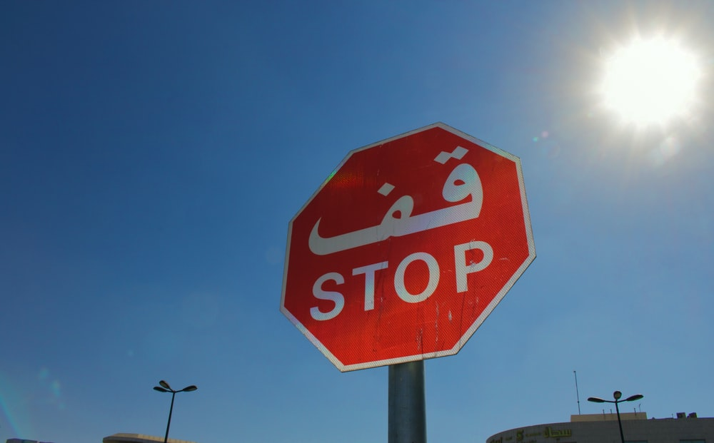 red stop road sign under blue sky during daytime