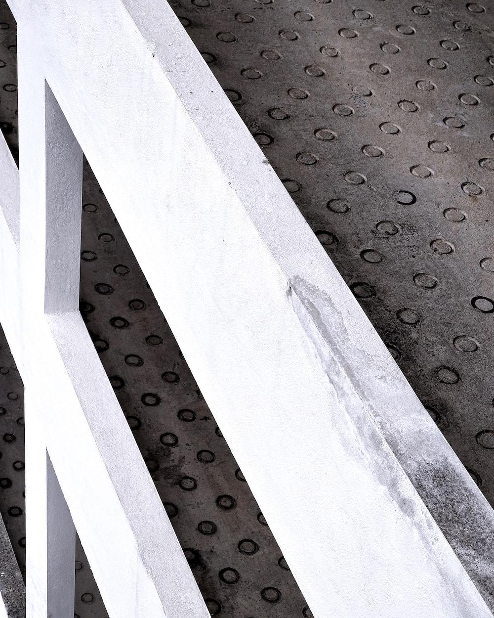 white concrete staircase with black and white polka dot pattern