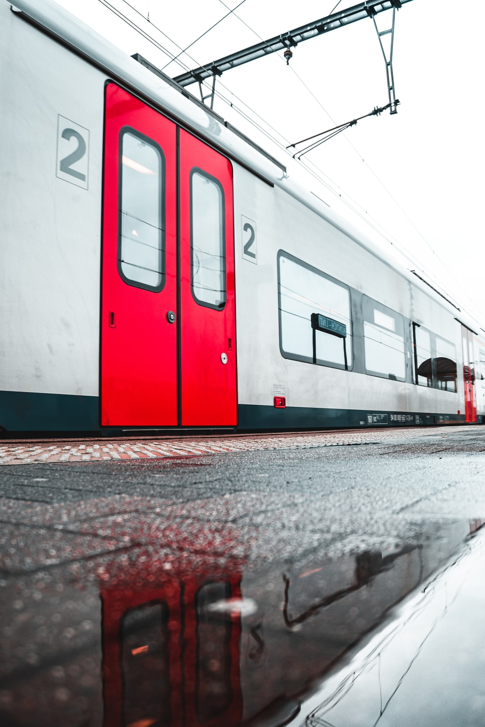 white and red train on train station