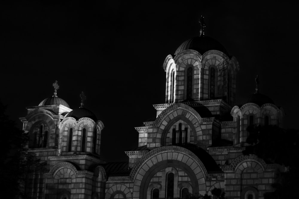 grayscale photo of church during daytime