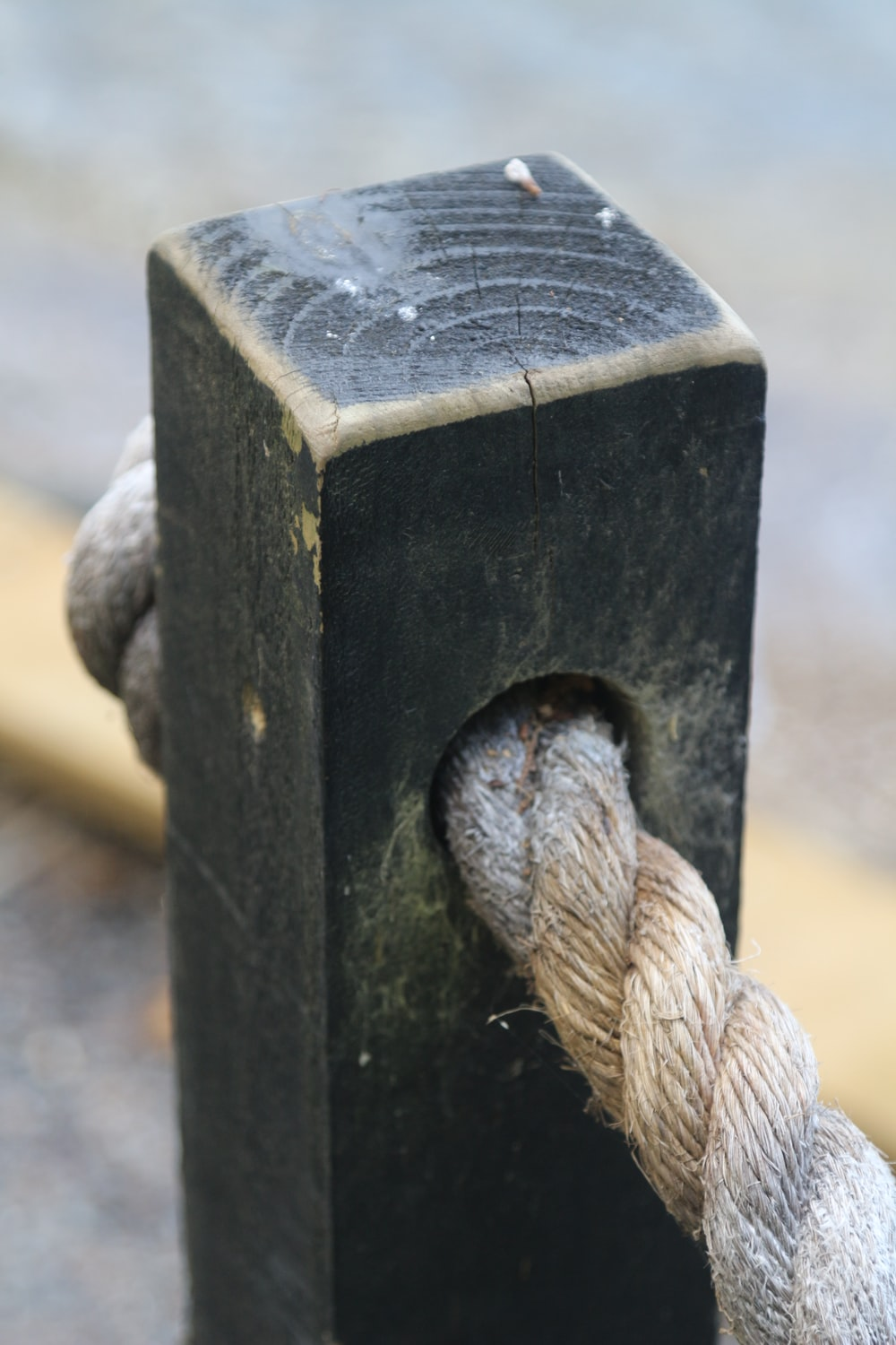 white rope on black wooden post