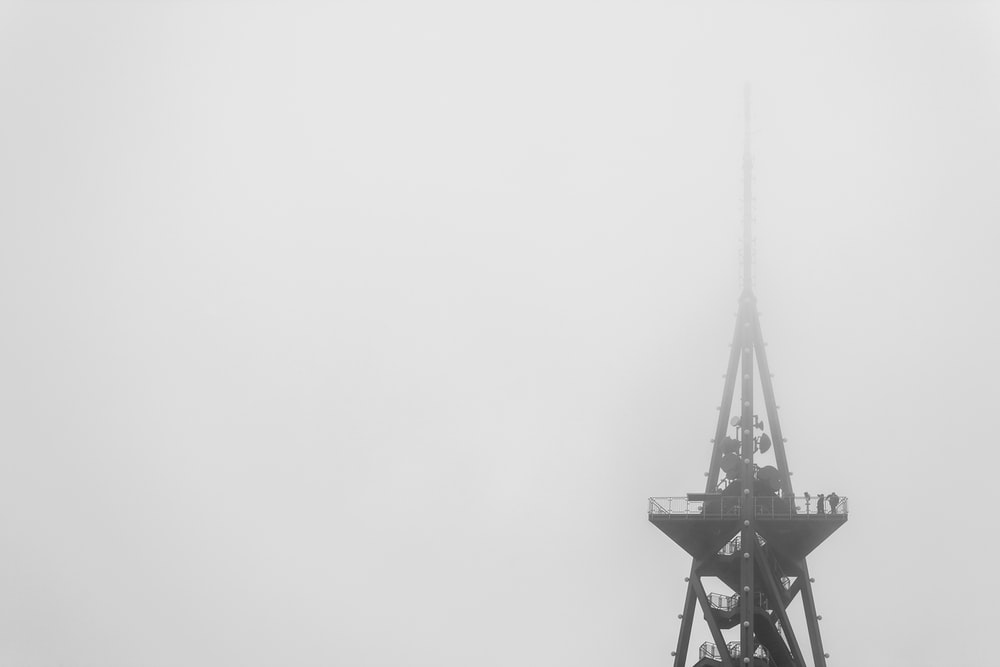 black metal tower under white sky