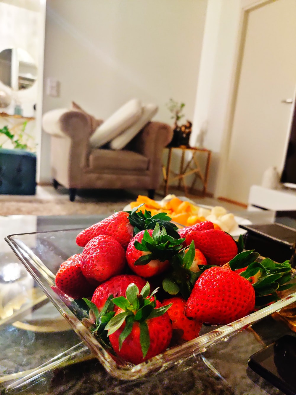 strawberries on clear glass bowl