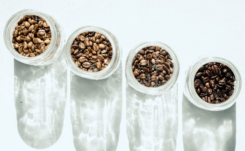 brown beans in clear glass containers