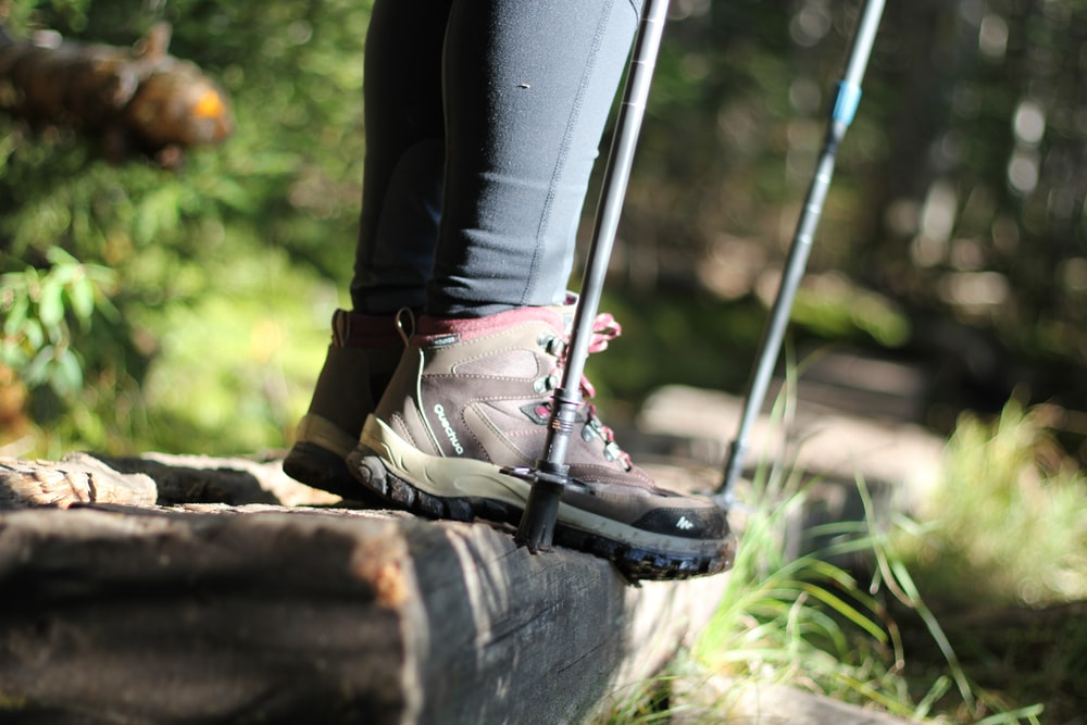 person wearing black and pink hiking boots