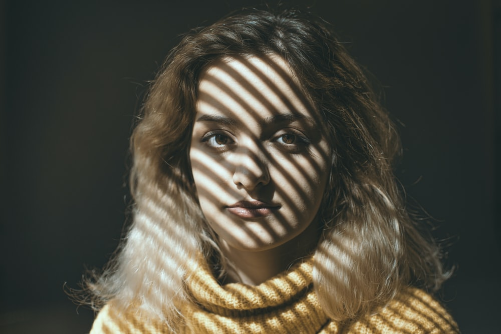woman in yellow knit scarf