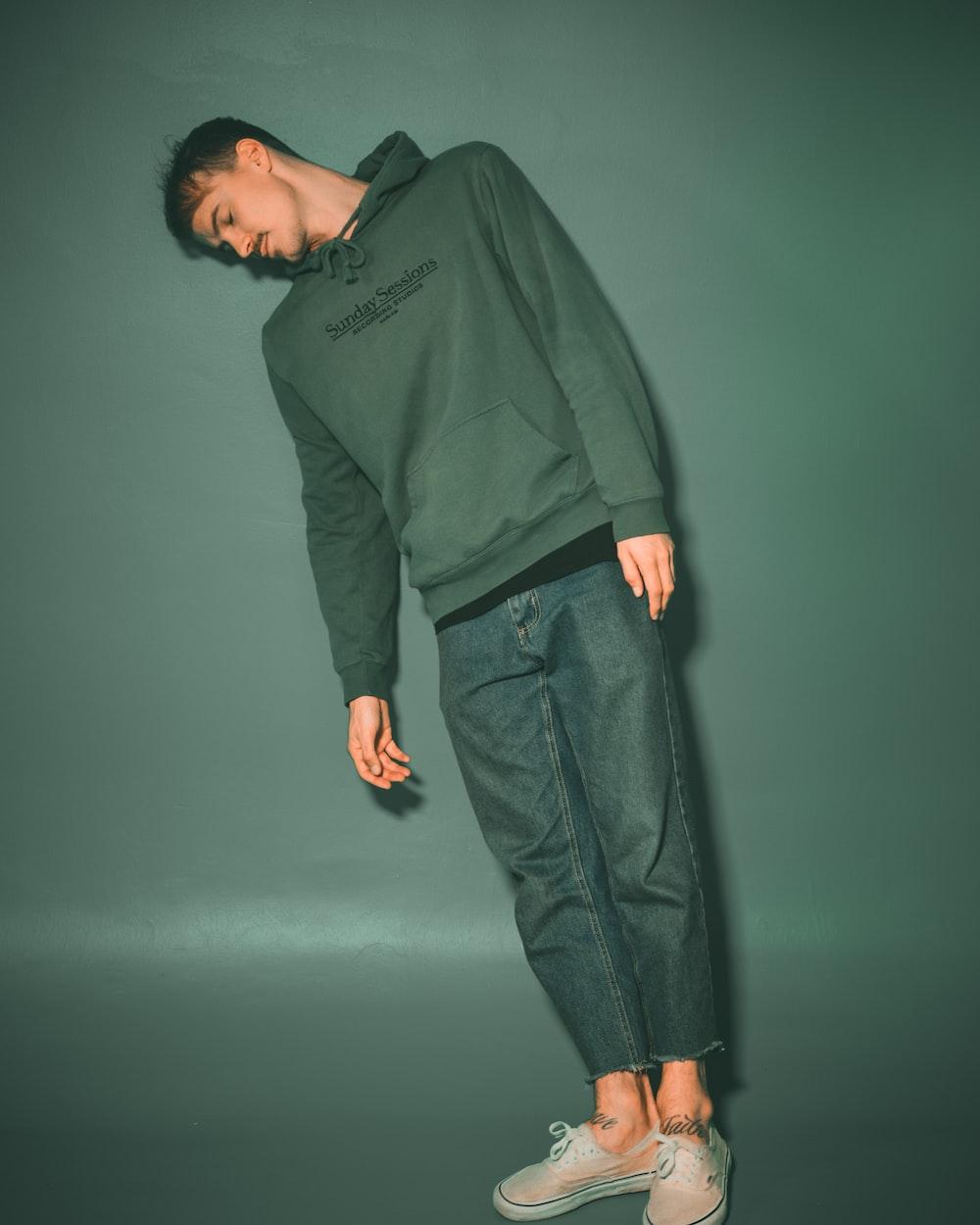 man in green long sleeve shirt and black pants