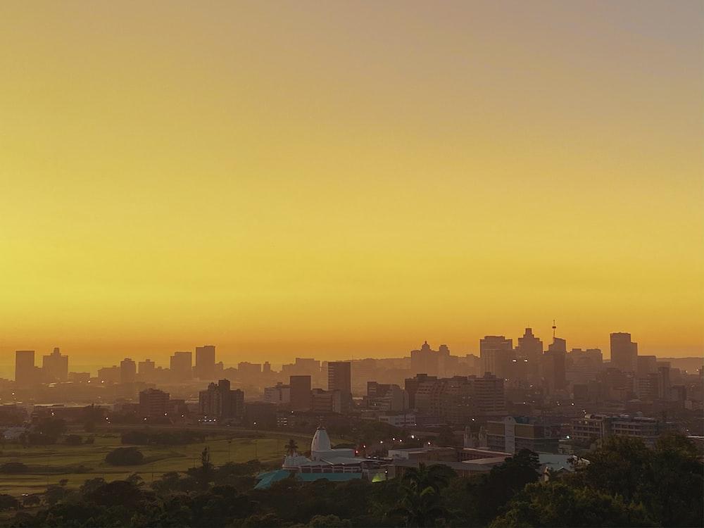 city skyline during orange sunset
