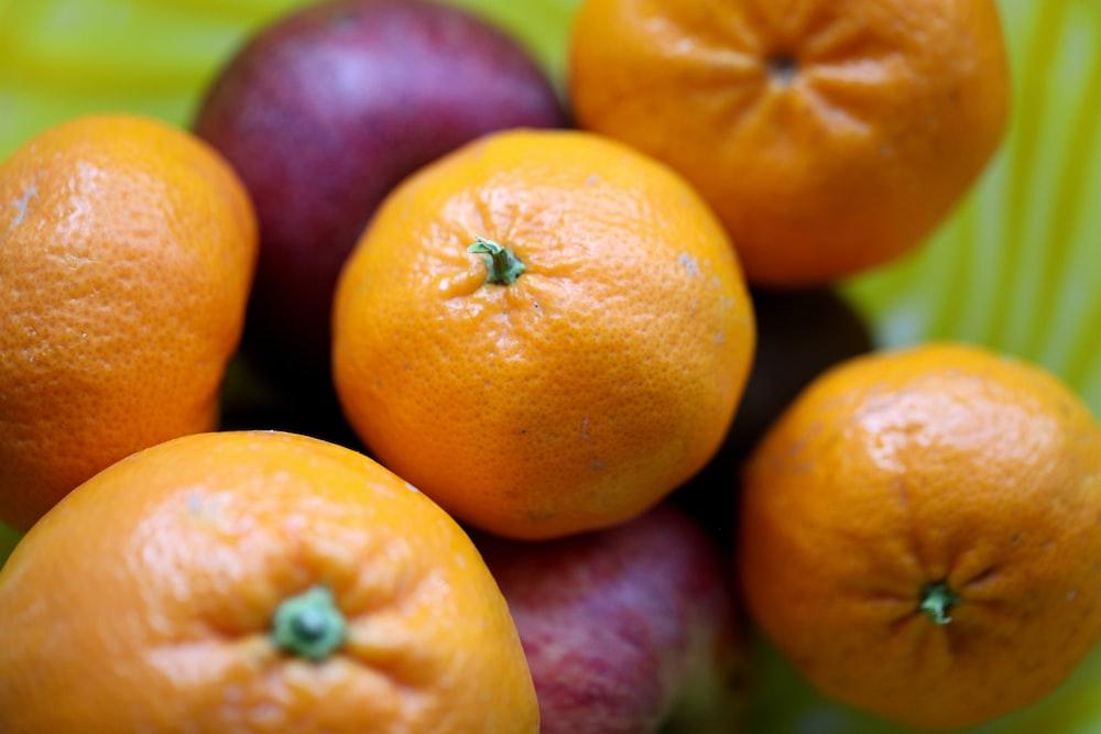 orange fruits on purple plastic container