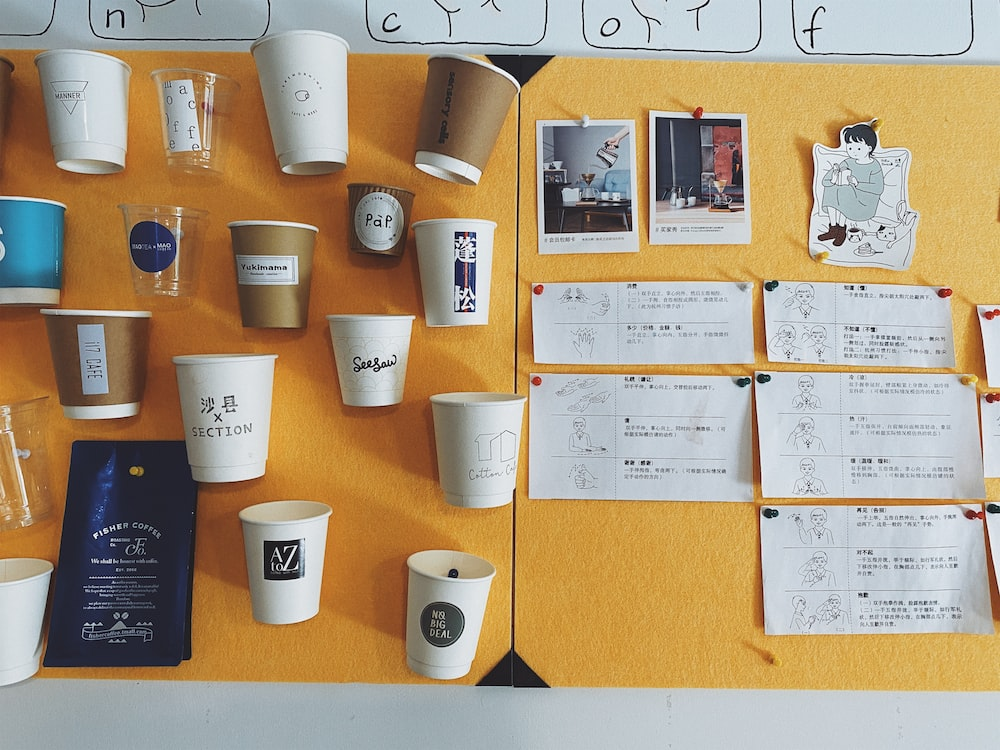 white paper cup on brown wooden table