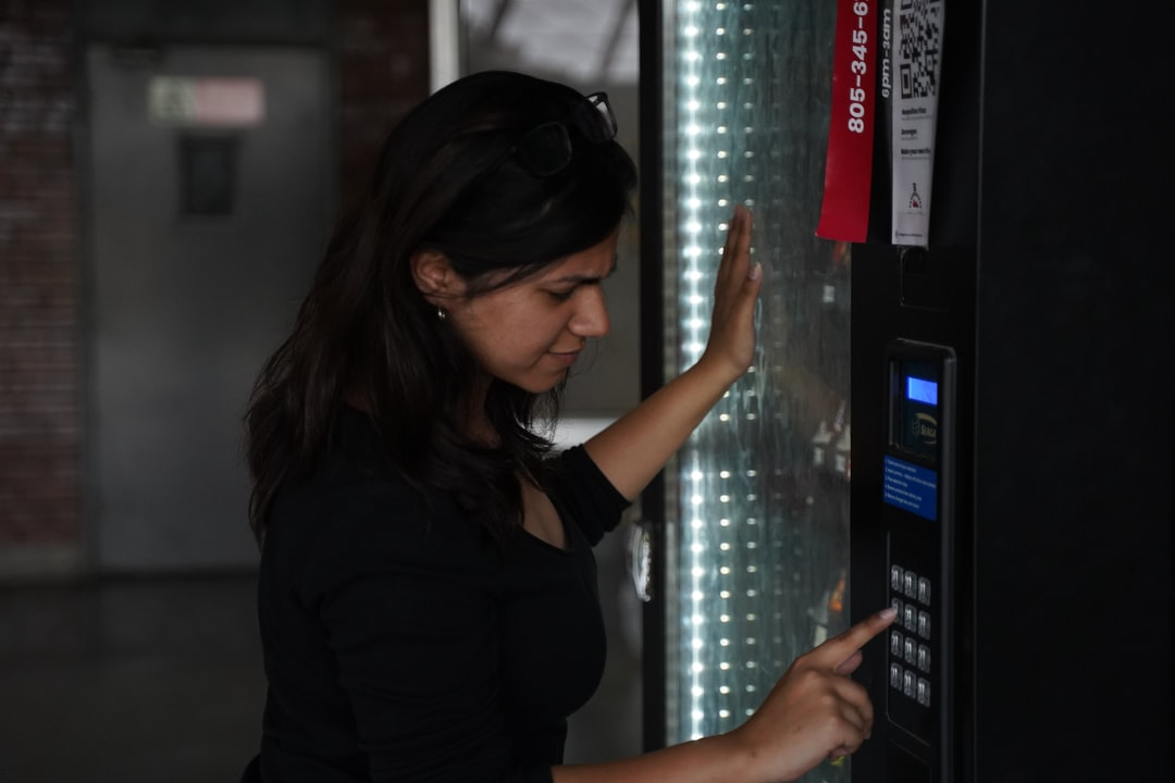 A girl using the vending machine. Theme: Impatience.
