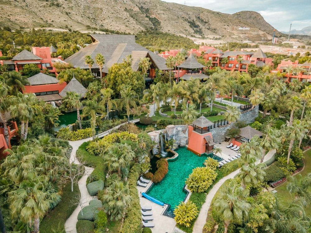 aerial view of houses and trees near mountain during daytime