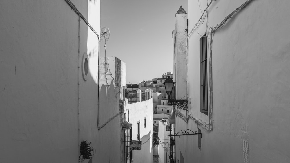 grayscale photo of a city with cars
