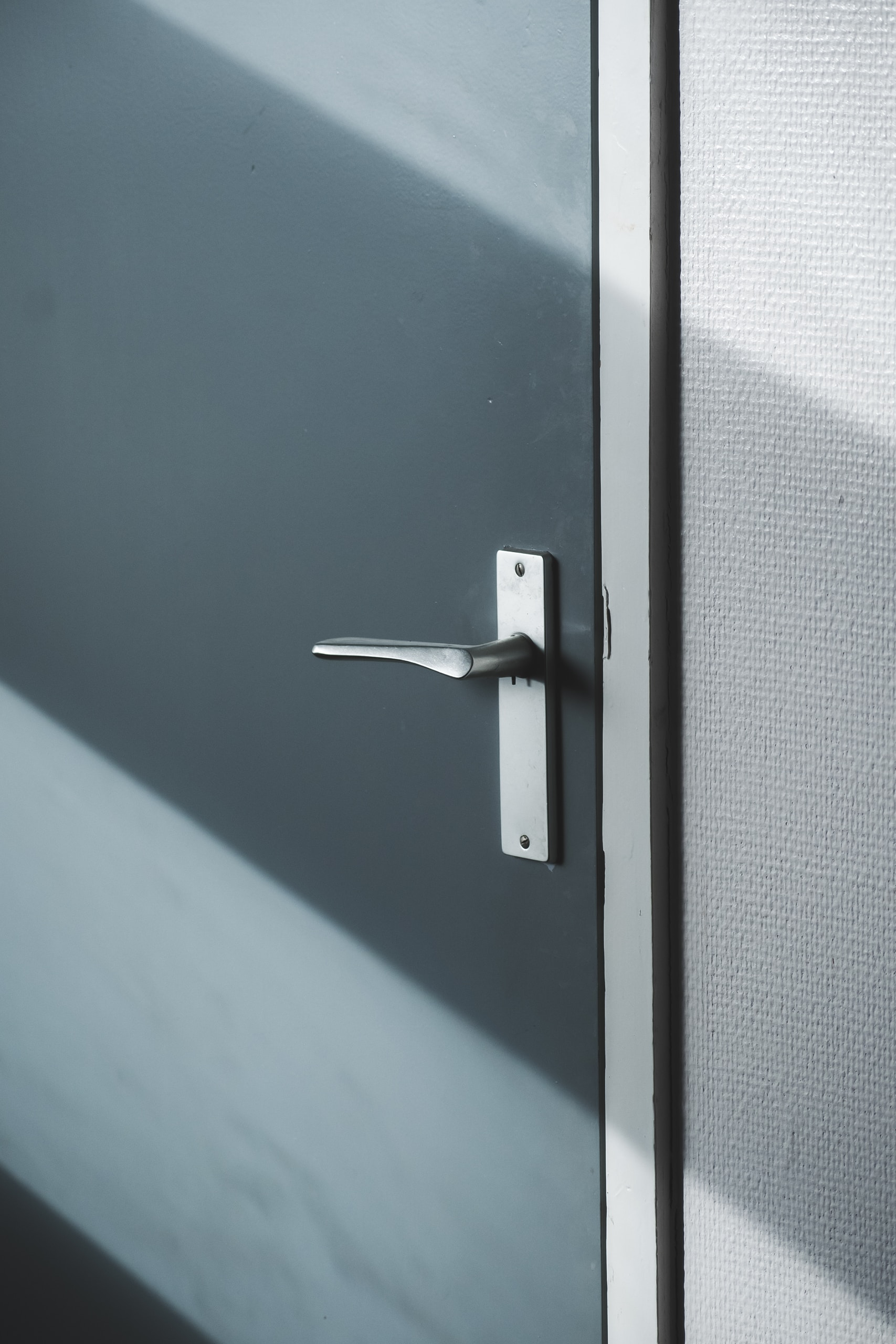 silver door lever on gray door