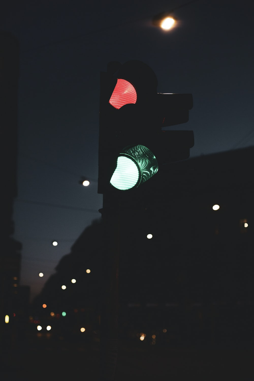 green traffic light during night time