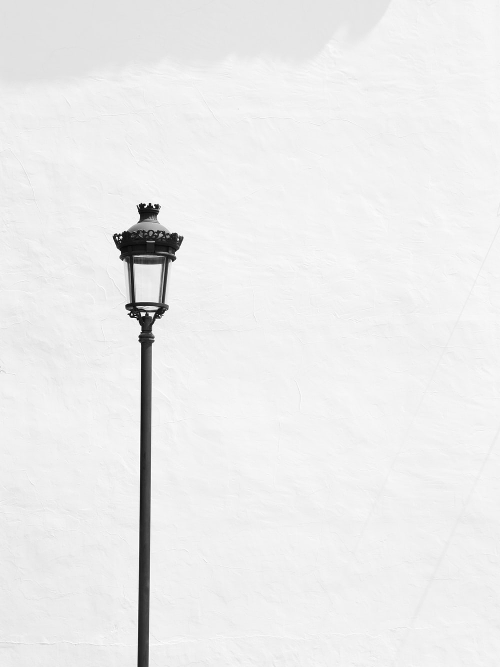 black street light post with white background