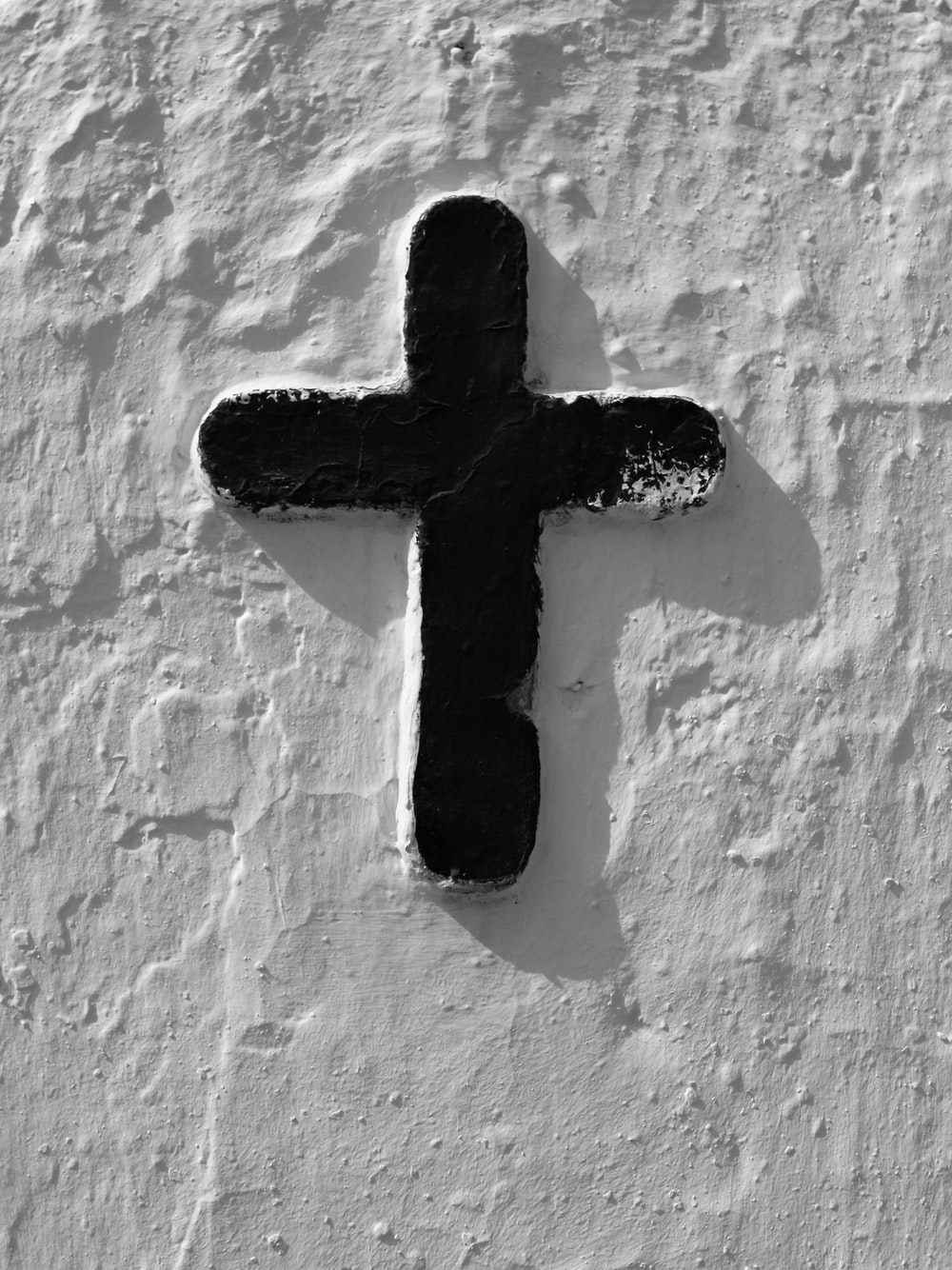 white and black cross wall decor