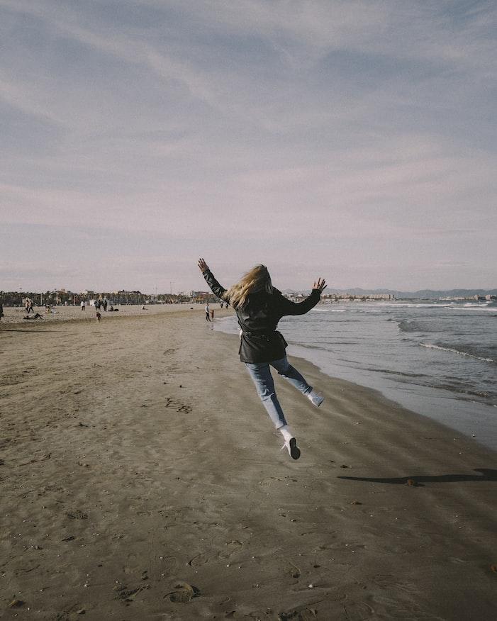 A girl enjoying in the Malvarrosa Beach
