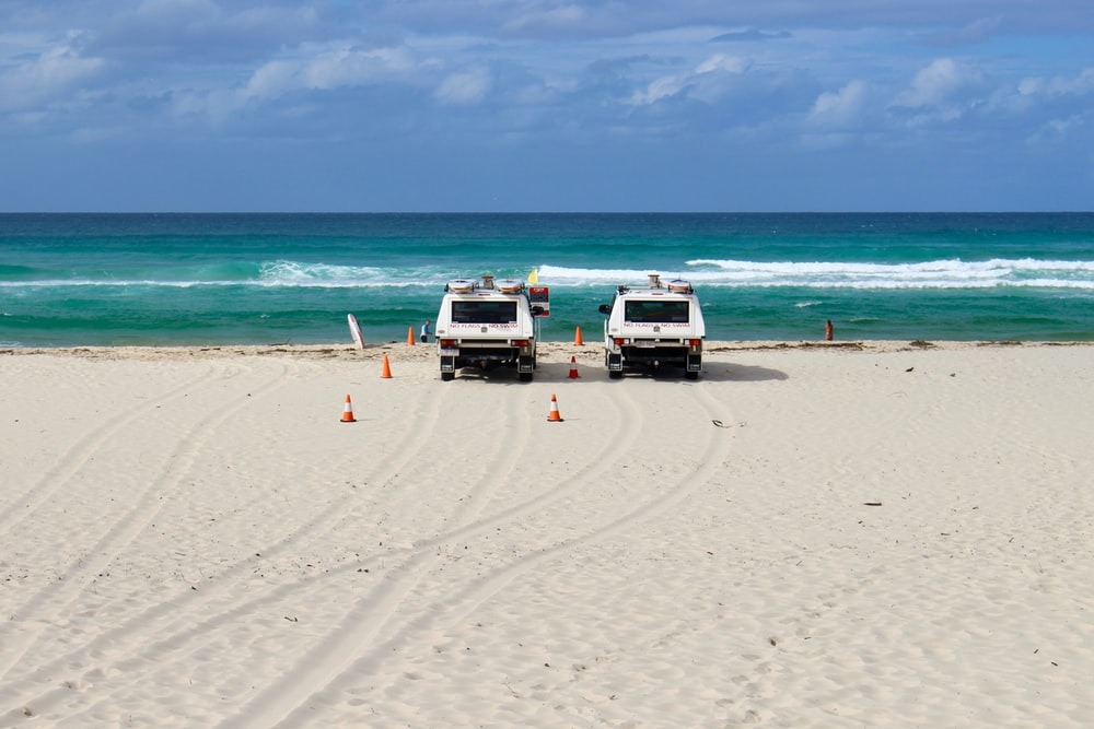 white suv on beach during daytime