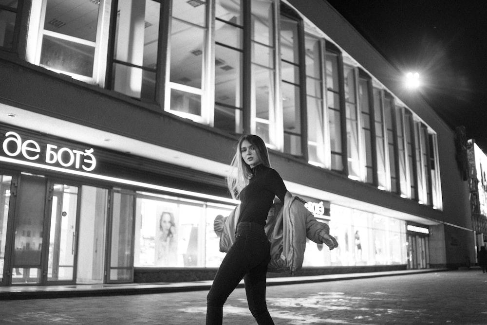 woman in black jacket and pants standing on floor