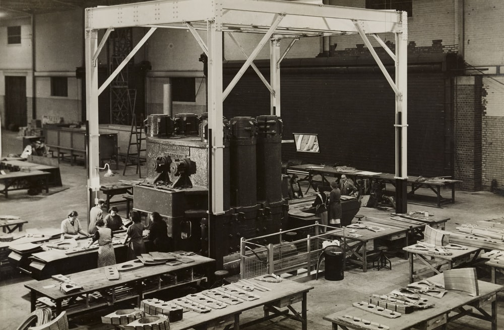 grayscale photo of people inside building