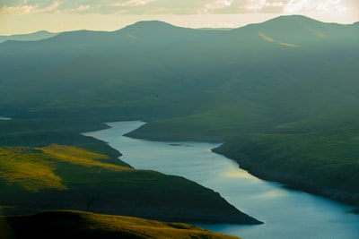 green mountains near lake during daytime lesotho teams background