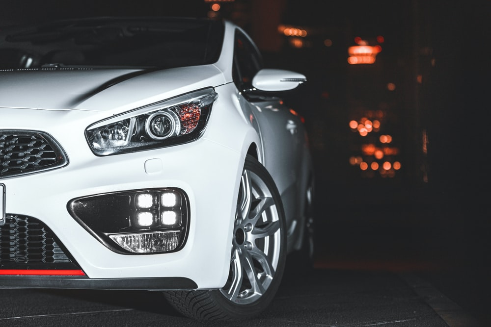 white bmw m series on road during night time