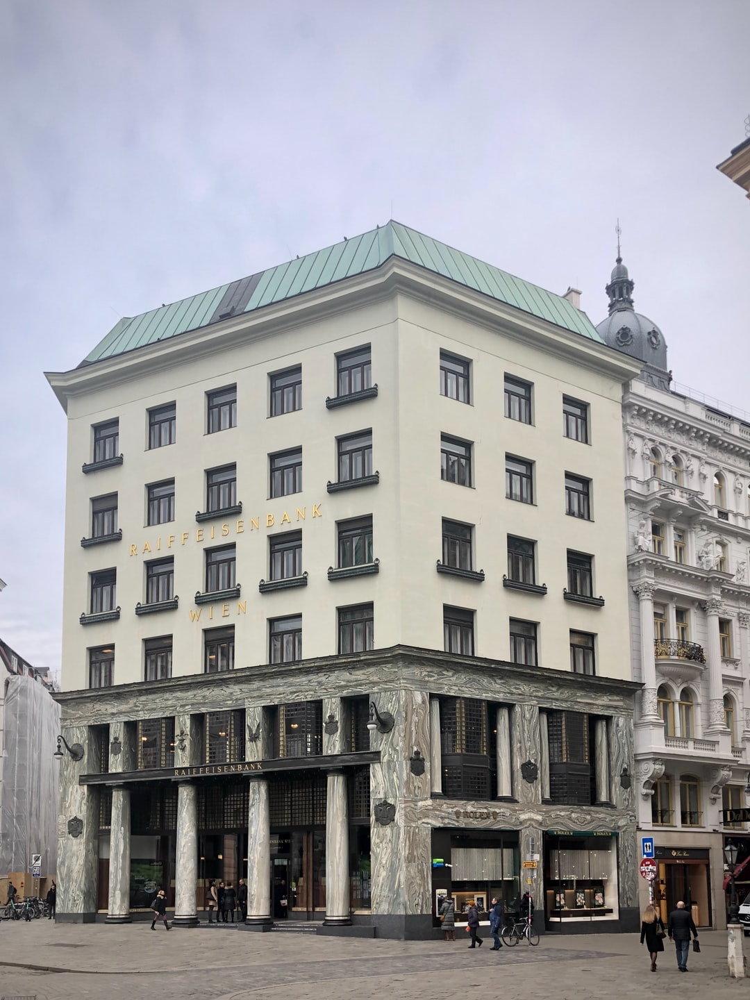 """The famous Looshaus of 1912 which marks a new era in architecture, Modernism, leaving behind Historism but as well the Jugendstil (Art Deco) of Secession. Its sober style lead to harsh criticism: the flower baskets of the upper windows had to be added as decorative element. It was called """"the house without eyebrows"""".  Now used as a bank and for exhibitions. March 09, 2020, 1000 AM - a very very sad day anyway."""