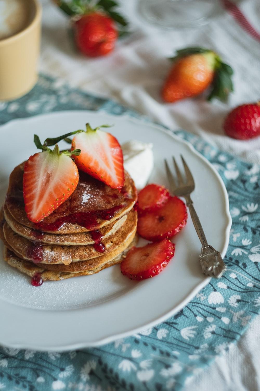 strawberry and chocolate cake on white ceramic plate