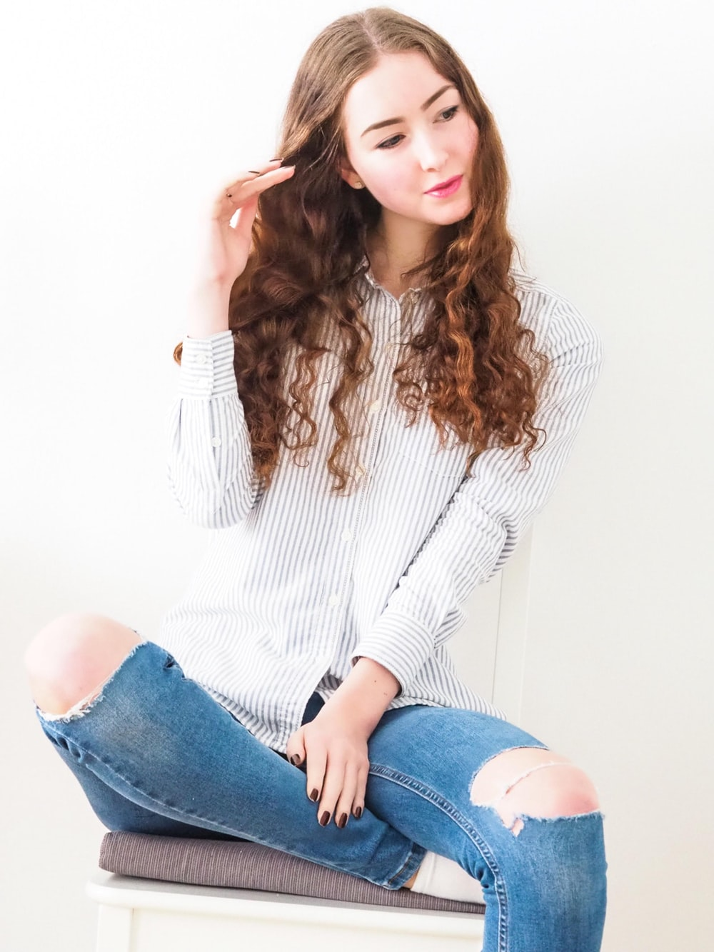 woman in white knit sweater and blue denim jeans