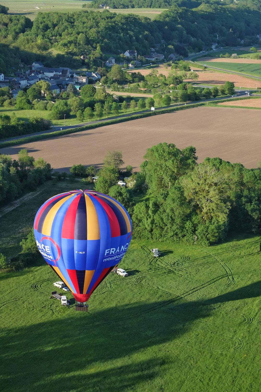 hot air balloon on green grass field during daytime