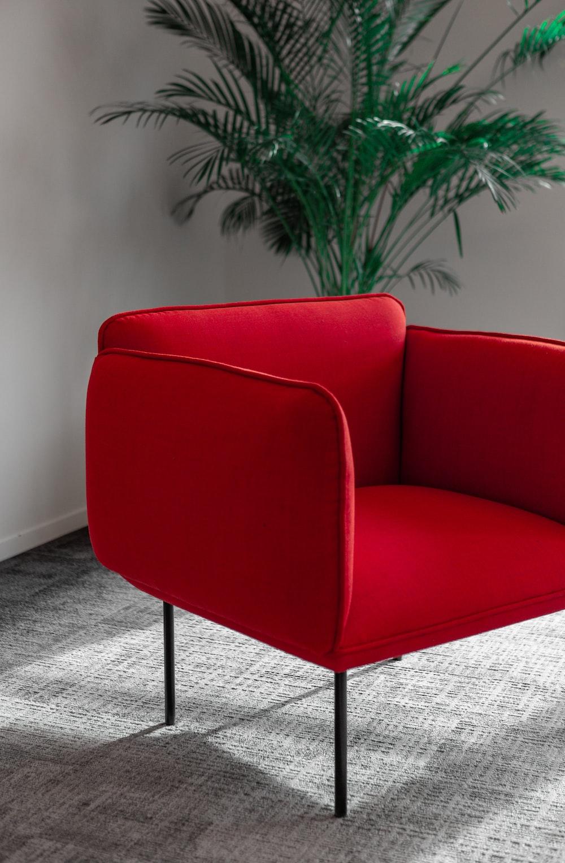 red sofa chair near green plant