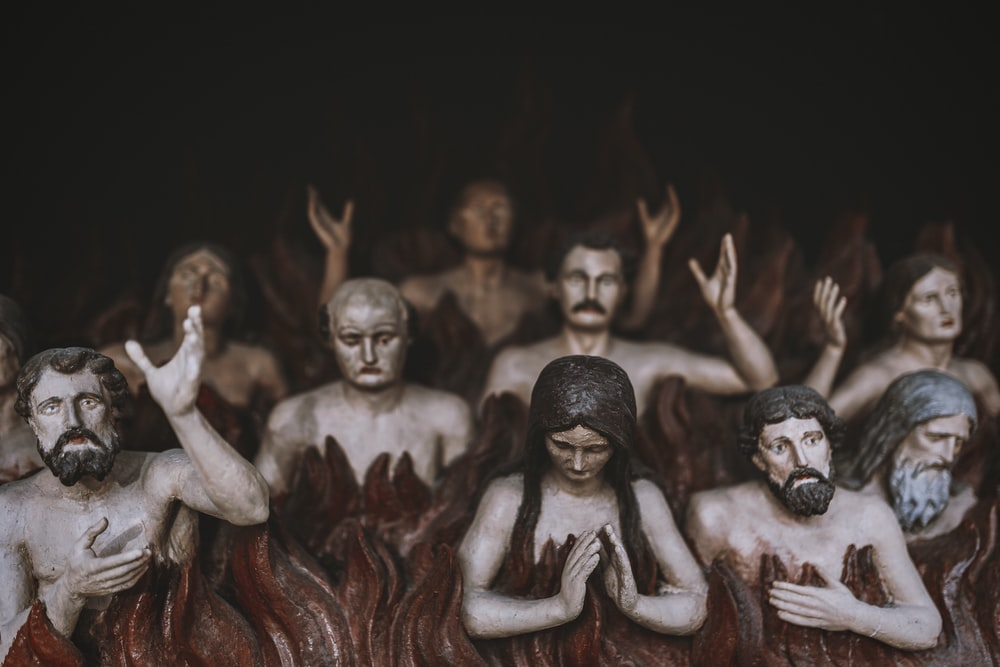 group of people covered with red powder